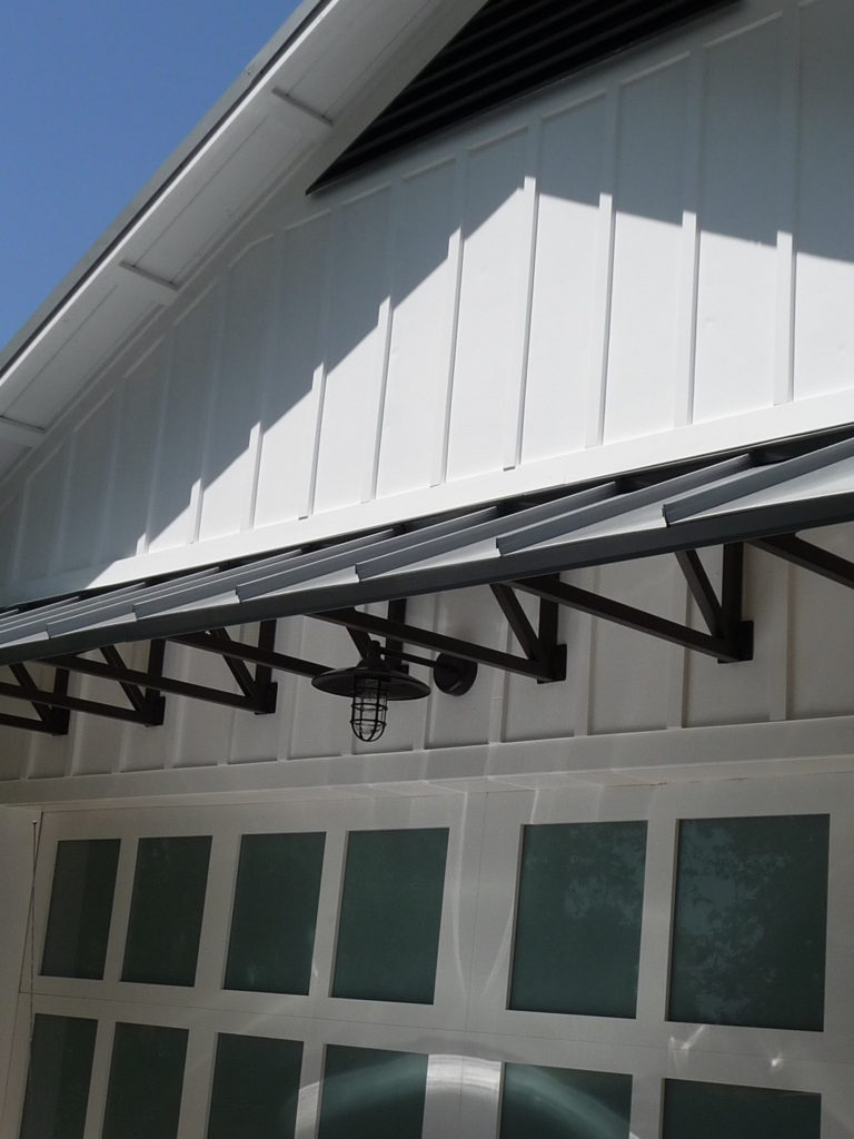 Remodel board and batten and standing seam metal roof